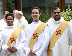 Jack Krouse, SJ, (center) with other newly ordained Jesuit deacons
