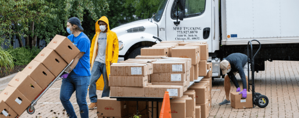 Chicago Jesuit Academy distributed boxes of food to families in need in the neighborhood, with the program reaching a peak of 600 25-pound boxes a week.